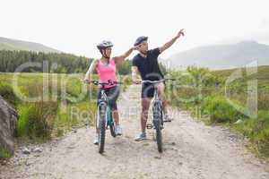Athletic couple on a bike ride
