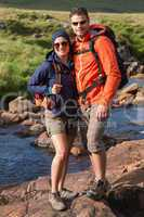 Smiling couple on a hike
