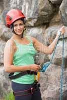 Pretty rock climber about to start her climb