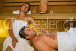 Loving couple relaxing in a sauna
