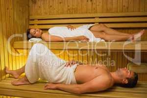 Calm couple relaxing in a sauna
