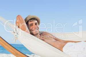 Smiling man wearing straw hat looking at camera