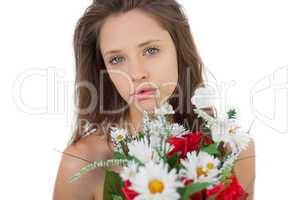 Calm brunette model holding a bouquet of flowers