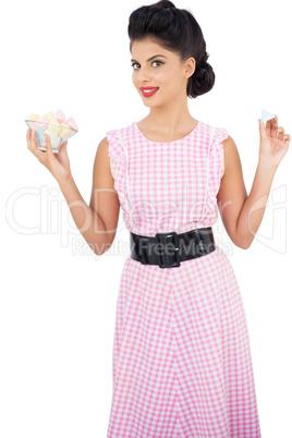 Pleased black hair model holding candies