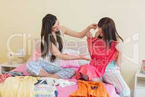 Girls looking at dresses at a sleepover