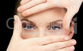 Sensual blonde making frame around her blue eyes