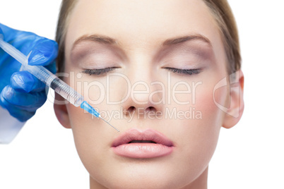 Peaceful pretty model having botox injection above the lips