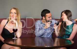 Blonde woman feeling lonely as two people are flirting beside he
