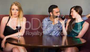 Blonde woman feeling jealous as two people are flirting beside h