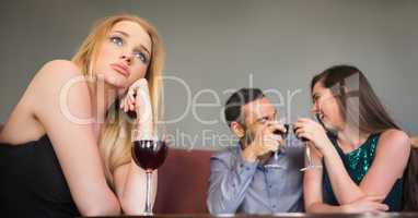 Blonde woman feeling jealous of two people are flirting beside h
