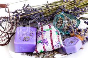 Lavender flowers with soap and glass