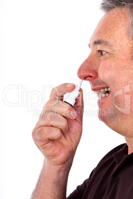 Man spraying nose drops