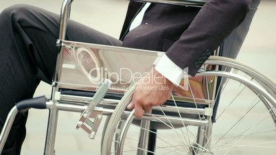 2of15 Health and handicap, business people on wheelchair outdoors