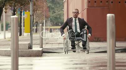 15of15 Health and handicap, business people on wheelchair outdoors