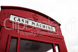 red telephone booth converted to cash machine