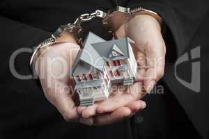 Woman In Handcuffs Holding Small House