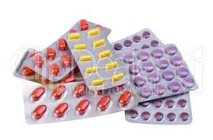 medicine pills and capsules packed in blisters