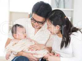 Parents pampering baby