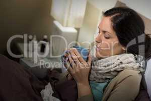 Ill Caucasian woman lying in bedroom