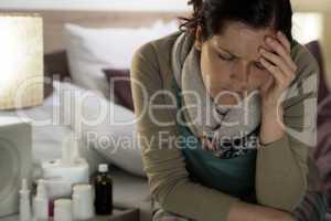 Ill woman with medicines suffer flu headache