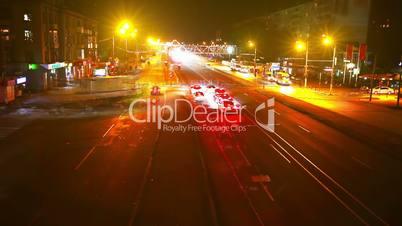 Timelapse of traffic on bridge at night. Blurred motion