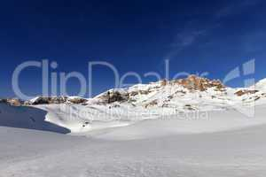 Snow plateau and blue sky in sunny spring day