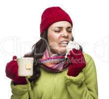 Sick Mixed Race Woman Drinks Hot Tea While Blowing Nose .