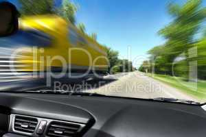 blurred on the speed of the movement of trucks on the road