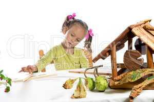 small girls in do handicraft
