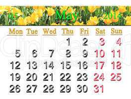 calendar for may of 2014 with tulips on the flower-bed