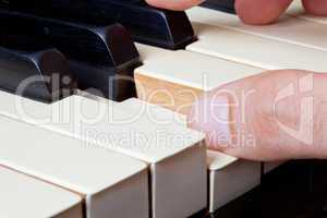 piano keyboard made of ivory with hands