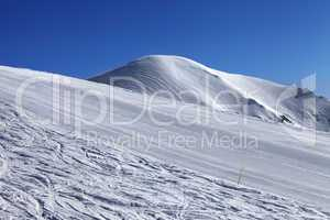 ski slope and blue cloudless sky in nice winter day