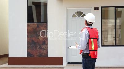 Male Building Inspector Taking Notes