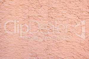 wand aus beton mit rosa anstrich