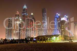 beach in night illumination at the luxury hotel, dubai, uae