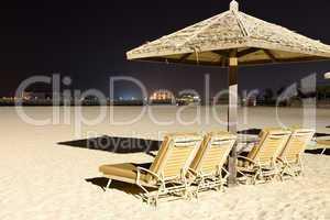 beach night illumination with a view on palm jumeirah, dubai, ua
