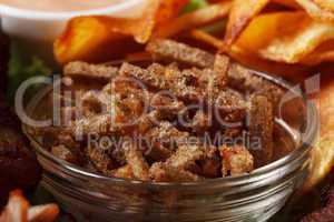Bowl with appetizing spicy rye crackers