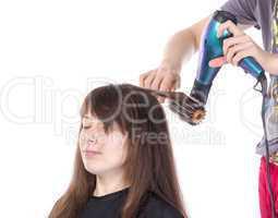 woman enjoying having her hair blow dried