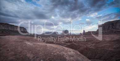 big cloud with sand in monument valley panorama