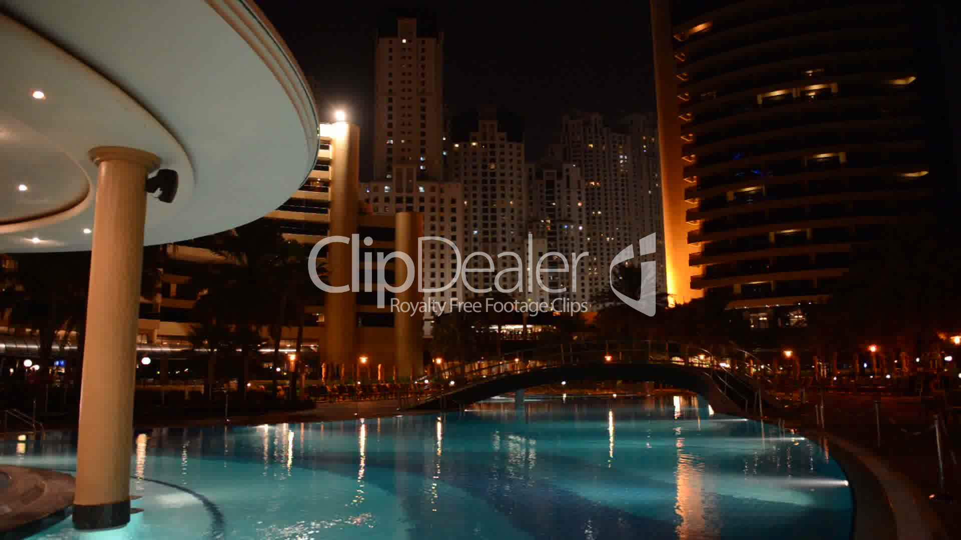 The swimming pool at luxury hotel in night illumination for Top 20 hotels in dubai