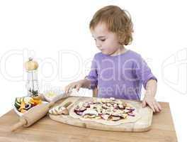 preschooler making fresh pizza