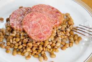 Pig trotter with lentils, traditional italian food