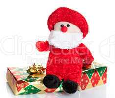 Colorful gift boxes with Santa Claus puppet