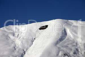 trace of avalanche on off-piste slope in sunny day
