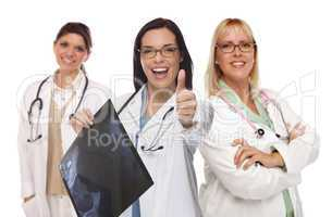 three female doctors or nurses with thumbs up holding x-ray