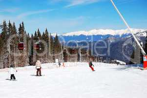 jasna-march 15: skiers rides on a slope in jasna low tatras. it