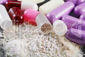 macro shot of medical powder from open capsules or pills