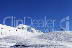 gondola lift and ski slope at nice day