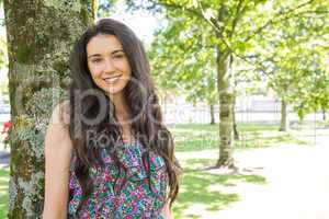 Stylish smiling brunette looking at camera