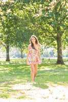 Stylish smiling brunette walking